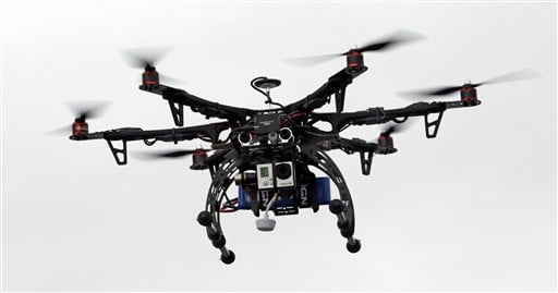 In this Feb. 13, 2014 file photo, a drone is demonstrated in Brigham City, Utah.