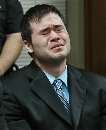 Daniel Holtzclaw cries as the verdicts are read in his trial in Oklahoma City, Thursday, Dec. 10, 2015. Holtzclaw, a former Oklahoma City police officer, was facing dozens of charges alleging he sexually assaulted several women while on duty.