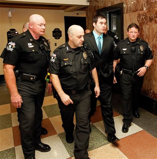 Former Oklahoma City police officer Daniel Holtzclaw, center, is taken to the courtroom to hear the verdict in the charges against him at the Oklahoma County Courthouse in Oklahoma City, Thursday, Dec. 10, 2015.
