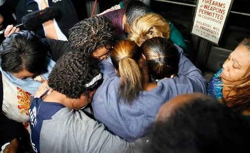 Supporters of the victims of former Oklahoma City police officer Daniel Holtzclaw pray after the verdicts were read for the charges against him at the Oklahoma County Courthouse in Oklahoma City, Thursday, Dec. 10, 2015.