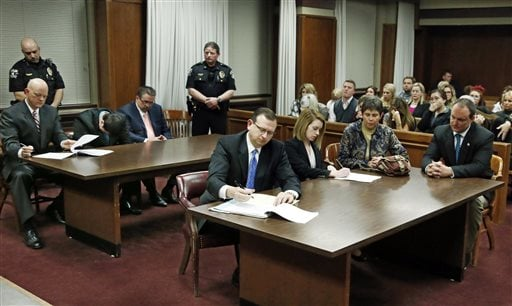 Gayland Gieger, center, Oklahoma County assistant district attorney, takes notes as defendant Daniel Holtzclaw, second from left, cries as the verdicts are read in his trial in Oklahoma City, Thursday, Dec. 10, 2015.
