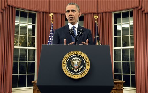In this Dec. 6, 2015, photo, President Barack Obama addresses the nation from the Oval Office at the White House in Washington. Fears of terrorism are hanging over America's holiday season, and Obama plans a series of events this week aimed at trying to a
