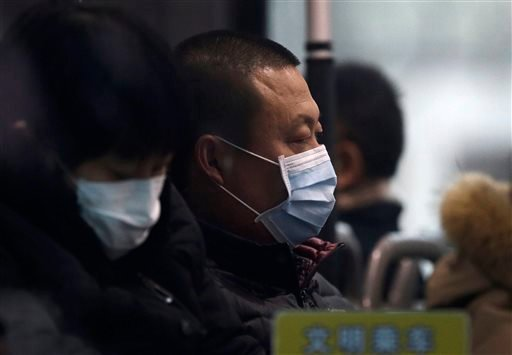 ommuters wear masks for protection against the pollution inside a bus on a polluted day in Beijing, Sunday, Dec. 13, 2015. China's push for a global climate pact is partly because of its own increasingly pressing need to solve serious environmental proble