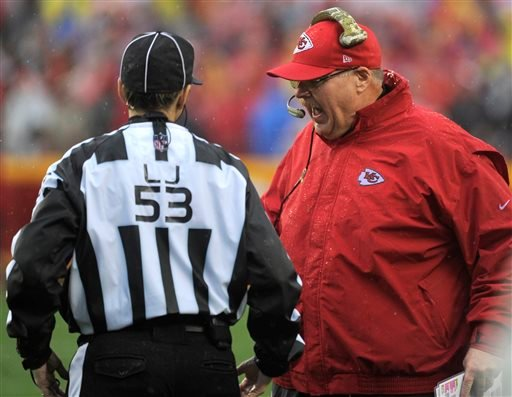 Kansas City Chiefs head coach Andy Reid, right, argues a call with line judge Sarah Thomas during the first half of an NFL football game in Kansas City, Mo., Sunday, Dec. 13, 2015. (AP Photo/Ed Zurga)