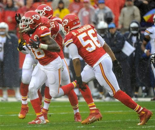 Kansas City Chiefs safety Ron Parker (38) reacts after sacking San Diego Chargers quarterback Philip Rivers during the first half of an NFL football game in Kansas City, Mo., Sunday, Dec. 13, 2015. (AP Photo/Ed Zurga)