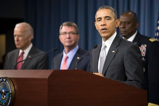 President Barack Obama, accompanied by, from left, Vice President Joe Biden, Defense Secretary Ash Carter and Commander of U.S. Central Command Gen. Lloyd Austin, speaks at the Pentagon, Monday, Dec. 14, 2015, about the fight against the Islamic State gro