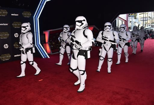"""Stormtroopers march on the red carpet at the world premiere of """"Star Wars: The Force Awakens"""" at the TCL Chinese Theatre on Monday, Dec. 14, 2015, in Los Angeles. (Photo by Jordan Strauss/Invision/AP)"""