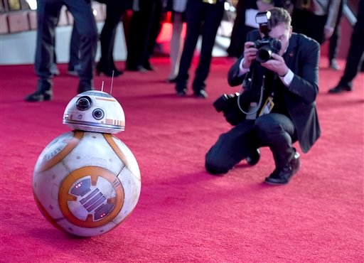 "Film character BB-8 arrives at the world premiere of ""Star Wars: The Force Awakens"" at the TCL Chinese Theatre on Monday, Dec. 14, 2015, in Los Angeles. (Photo by Jordan Strauss/Invision/AP)"