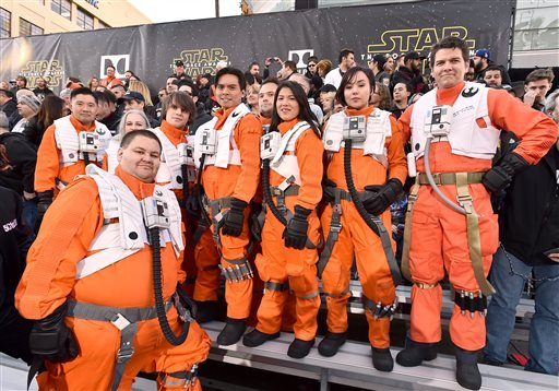 "Fans dressed in character wait in the stands at the world premiere of ""Star Wars: The Force Awakens"" at the TCL Chinese Theatre on Monday, Dec. 14, 2015, in Los Angeles. (Photo by Jordan Strauss/Invision/AP)"