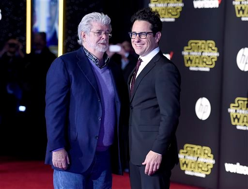 """George Lucas, left, and J.J. Abrams arrive at the world premiere of """"Star Wars: The Force Awakens"""" at the TCL Chinese Theatre on Monday, Dec. 14, 2015, in Los Angeles."""