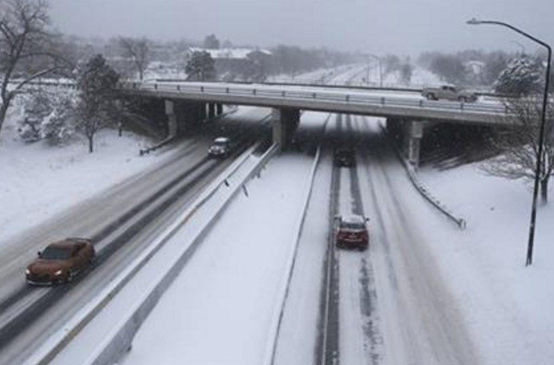 Motorists brave slippery roads after a night of heavy snowfall, in Boulder, Colo., Tuesday, Dec. 15, 2015. The biggest winter storm to hit the Denver area so far this season has left most schools closed and created some havoc on the roads. AP