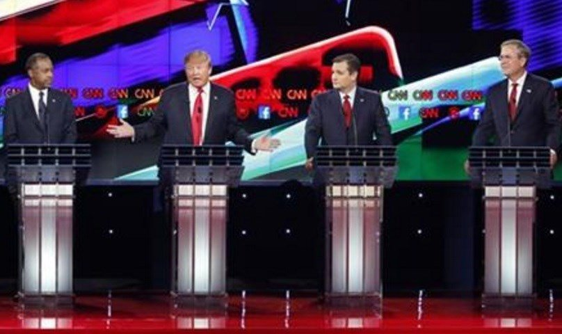 Donald Trump, second from left, makes a point as Ben Carson, left, Ted Cruz, second from right, and Jeb Bush look on during the CNN Republican presidential debate at the Venetian Hotel & Casino on Tuesday, Dec. 15, 2015, in Las Vegas. AP Photo/John Locher