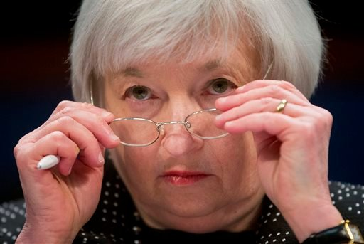 In this Feb. 25, 2015, file photo, Federal Reserve Chair Janet Yellen removes her glasses as she testifies on Capitol Hill in Washington. The Federal Reserve is widely expected to raise its key rate from record lows, on Wednesday, Dec. 16, 2015, potential