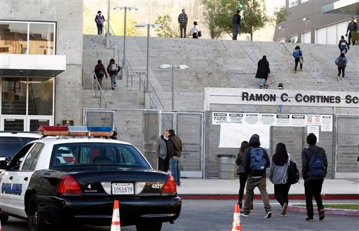 Students arrive at the Ramon C. Cortines School of Visual and Performing Arts in downtown Los Angeles on Wednesday, Dec. 16, 2015. Students are heading back to class a day after an emailed threat triggered a shutdown of the vast Los Angeles Unified School