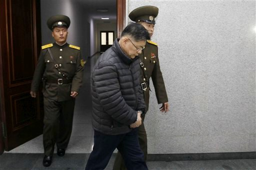 Hyeon Soo Lim, center, who pastors the Light Korean Presbyterian Church in Toronto, is escorted to his sentencing in Pyongyang, North Korea, Wednesday, Dec. 16, 2015. North Korea's Supreme Court sentenced a Canadian pastor to life in prison with hard labo