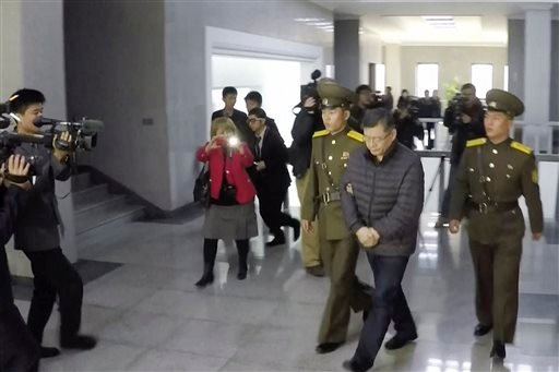 In this image made from video, Hyeon Soo Lim, who pastors the Light Korean Presbyterian Church in Toronto, is escorted to his sentencing in Pyongyang, North Korea, Wednesday, Dec. 16, 2015. North Korea's Supreme Court sentenced a Canadian pastor to life i