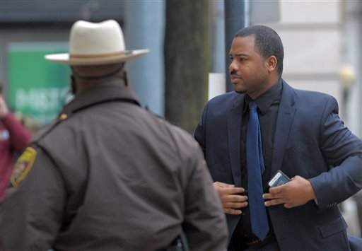 William Porter, right, one of six Baltimore city police officers charged in connection to the death of Freddie Gray, arrives at a courthouse as jury deliberations continue in his trial, Wednesday, Dec. 16, 2015, in Baltimore. Porter faces charges of mansl