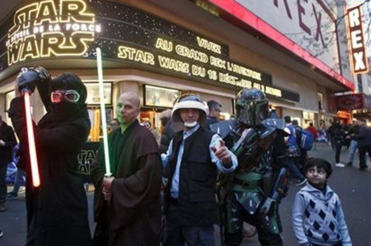 "People dressed in character pose outside the Grand Rex movie theater for photographers prior to a screening of ""Star Wars: The Force Awakens""in Paris, Wednesday, Dec. 16, 2015. (AP Photo/Michel Euler)"