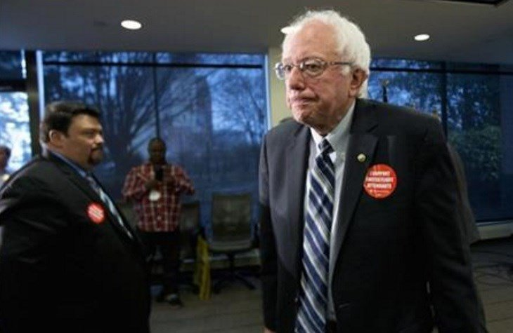 Democratic presidential candidate Sen. Bernie Sanders, I-Vt., leaves a news conference where he was endorsed by members of the Communication Workers of America (CWA), Thursday, Dec. 17, 2015, at the CWA's headquarters in Washington. (AP Photo)