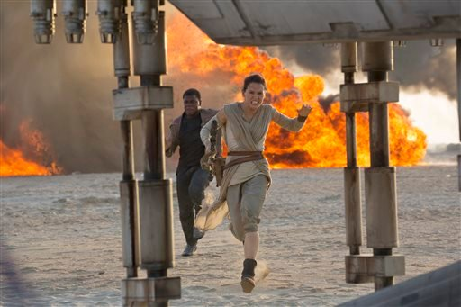 "This photo provided by Disney/Lucasfilm shows Daisy Ridley, right, as Rey, and John Boyega as Finn, in a scene from the film, ""Star Wars: The Force Awakens,"" directed by J.J. Abrams. The movie opens in U.S. theaters on Friday, Dec. 18, 2015. (David James/"