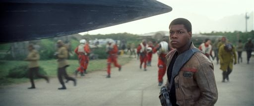"This photo provided by Disney shows John Boyega as Finn, in a scene from the new film, ""Star Wars: The Force Awakens,"" directed by J.J. Abrams. The movie releases in the U.S. on Friday, Dec. 18, 2015. (Film Frame/Disney/Lucasfilm via AP)"