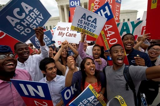 In this June 25, 2015, file photo, students cheer as they hold up signs, outside of the Supreme Court in Washington, supporting the Affordable Care Act after the Supreme Court decided that the ACA may provide nationwide tax subsidies. Republican foes of P