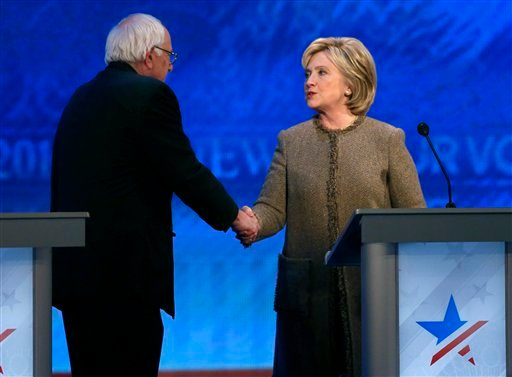 Bernie Sanders, left, speaks to Hillary Clinton after a Democratic presidential primary debate Saturday, Dec. 19, 2015, at Saint Anselm College in Manchester, N.H. (AP Photo/Jim Cole)