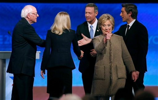 Hillary Clinton, second from right, gives a thumbs-up in front of Bernie Sanders, left, debate moderator Martha Raddatz, second from left, Martin O'Malley, center, and debate moderator David Muir at the conclusion of a Democratic presidential primary deba