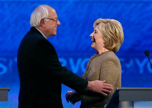 Bernie Sanders, left, speaks with Hillary Clinton during a break at a Democratic presidential primary debate Saturday, Dec. 19, 2015, at Saint Anselm College in Manchester, N.H. (AP Photo/Jim Cole)