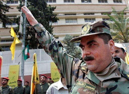 In this July 17, 2008, file photo, released prisoner Samir Kantar salutes people as he arrives to pay respect at the grave of slain top Hezbollah military commander Imad Mughniyeh, south of Beirut, Lebanon. Kantar, the longest-held Lebanese prisoner in Is
