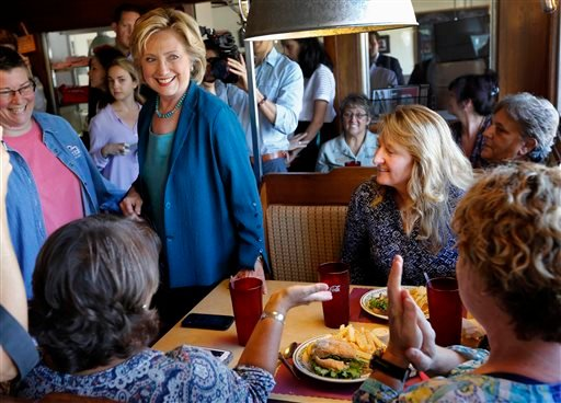 In this Sept. 17, 2015, file photo, Democratic presidential candidate Hillary Clinton talks with customers during a campaign stop at the Union Diner in Laconia, N.H. (AP Photo/Jim Cole, File)