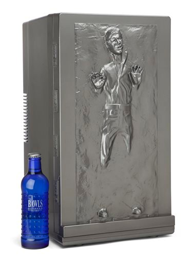 This photo provided by ThinkGeek shows the Han Solo Fridge. This mini fridge's front door features a 3-D rendering of a frosty Han and holds 18 canned beverages. (ThinkGeek via AP)