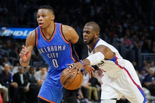 Los Angeles Clippers' Chris Paul, right, tries to steal the ball from Oklahoma City Thunder's Russell Westbrook during the second half of an NBA basketball game, Monday, Dec. 21, 2015, in Los Angeles.
