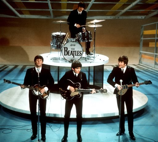"In this Feb. 9, 1964 file photo, The Beatles perform on the CBS ""Ed Sullivan Show"" in New York."