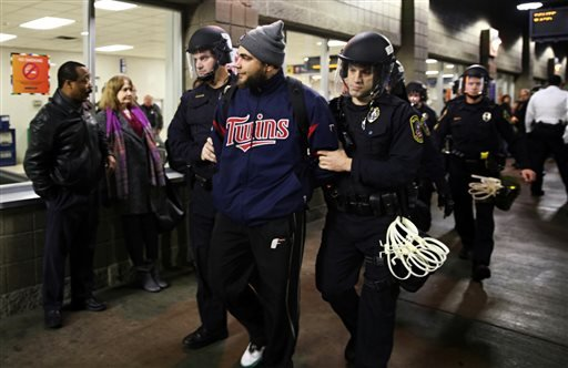 Law enforcement detained a protester at the Mall of America. A large protest that started at the Mall of America quickly migrated Wednesday, Dec. 23, 2015, to Minneapolis-St. Paul International Airport, where demonstrators blocked roads and caused signifi