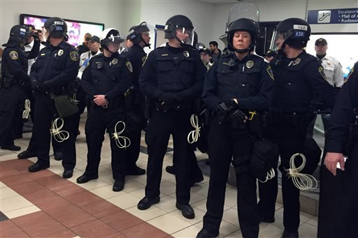 Law enforcement on the ground level tranport area at the Mall of America. A large protest that started at the Mall of America quickly migrated Wednesday, Dec. 23, 2015, to Minneapolis-St. Paul International Airport, where demonstrators blocked roads and c