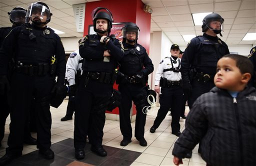 Law enforcement at the Mall of America transit area. A large protest that started at the Mall of America quickly migrated Wednesday, Dec. 23, 2015, to Minneapolis-St. Paul International Airport, where demonstrators blocked roads and caused significant tra