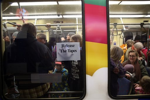 Protesters get on light rail at the Mall of America transit hub. A large protest that started at the Mall of America quickly migrated Wednesday, Dec. 23, 2015, to Minneapolis-St. Paul International Airport, where demonstrators blocked roads and caused sig