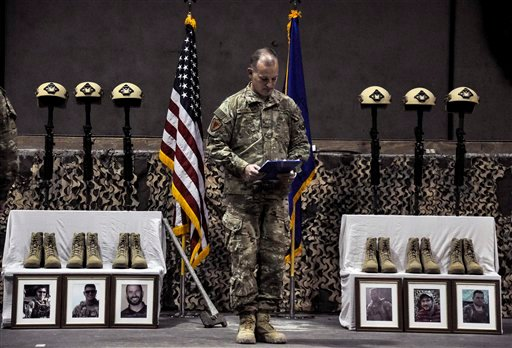 A U.S. Air Force officer speaks during a memorial ceremony for six Airmen killed in a suicide attack, at Bagram Air Field, Afghanistan on Wednesday, Dec. 23, 2015. The deadliest attack in Afghanistan since 2013 killed six U.S. troops on Monday, including