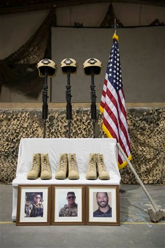 Helmets, rifles and boots represent three fallen U.S. Airmen during their memorial ceremony for six Americans killed in a suicide attack, at Bagram Air Field, Afghanistan on Wednesday, Dec. 23, 2015. The deadliest attack in Afghanistan since 2013 killed s