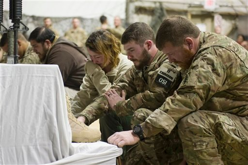 U.S. service members pay their respects during a memorial ceremony for six Airmen killed in a suicide attack, at Bagram Air Field, Afghanistan on Wednesday, Dec. 23, 2015. The deadliest attack in Afghanistan since 2013 killed six U.S. troops on Monday, in