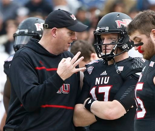 Northern Illinois coach Rod Carey instructs quarterback Ryan Graham during the first half against Boise State in the Poinsettia Bowl NCAA college football game Wednesday, Dec. 23, 2015, in San Diego. (AP Photo/Lenny Ignelzi)