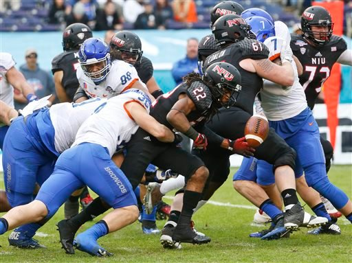 Northern Illinois wide receiver Aregeros Turner fumbles while being hit by Boise State linebacker Tyler Gray during the first half of the Poinsettia Bowl NCAA college football game Wednesday, Dec. 23, 2015, in San Diego. Boise State recovered the ball. (A