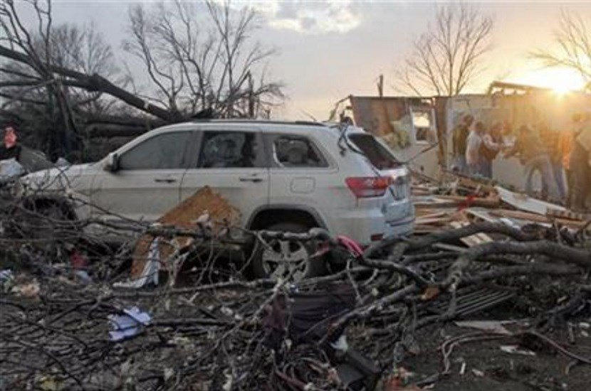 Neighbors help salvage items from a storm-damaged home in the Roundaway community near Clarksdale, Miss., Wednesday, Dec. 23, 2015. (Troy Catchings/The Press Register via AP)