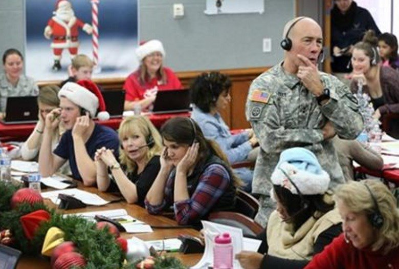 Hundreds of military and civilian volunteers at NORAD are estimated to field more than 100,000 calls this year through Christmas Eve, from children from all over the world eager to hear about Santa's progress. (AP Photo/Brennan Linsley, File)