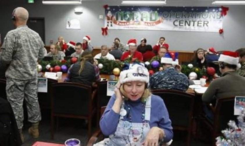 In this Dec. 24, 2014, file photo, volunteer Patty Shook takes a phone call from a child asking where Santa is and when he will deliver presents to her home, inside a phone-in center during the annual NORAD Tracks Santa Operation. AP