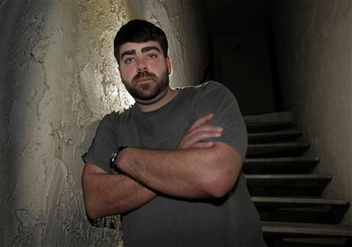 In this photo taken Thursday, Dec. 17, 2015, Josh Redmyer, a former Marine who served three tours in Iraq, poses in Oroville, Calif. Redmyer, who was diagnosed with Post-Traumatic Stress Disorder in 2009, received a less-than-honorable discharge in 2012.
