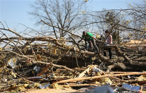 Volunteers help with clean up at Calvary Baptist Church following a tornado Thursday, Dec. 24, 2015, in Ashland, Miss. (Stan Carroll/The Commercial Appeal via AP)