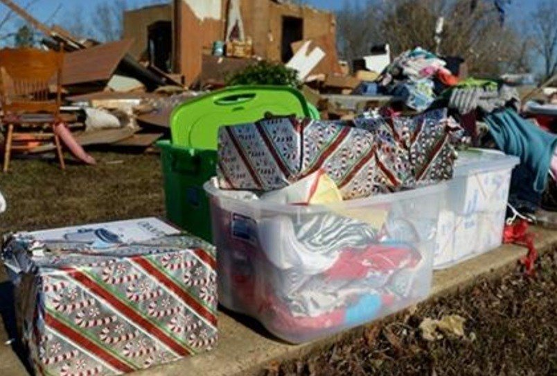 Christmas gifts are stacked outside of a demolished home that was affected by a tornado that came through Selmer, Wednesday, Dec. 23, 2015.