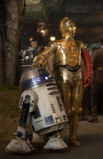 "This photo provided by Disney shows, R2-D2, left, and Anthony Daniels as C-3PO, in a scene from the new film, ""Star Wars: The Force Awakens,"" directed by J.J. Abrams. (David James/Disney/Copyright Lucasfilm 2015 via AP)"